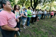 Volunteers hold photos of the 49 people killed Sunday in the Orlando nightclub shooting during a Thursday memorial service at Bergfeld Park in Tyler. A single bell tolled and the line of volunteers grew as each name was read, followed by a brief biography in the person and their age. Andrew D. Brosig/Tyler Morning Telegraph