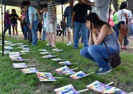 Esther Gonzalez, right, buries her face in her hands and weeps while viewing photos of the 49 people killed in the Orlando nightclub shooting during a vigil Thursday at Bergfeld Park in Tyler. Hosted by a variety of organizations from across the community scores came to the park to remember and grieve. Andrew D. Brosig/Tyler Morning Telegraph